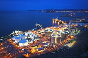 industrial factory at the night - cyber threats pack a physical punch